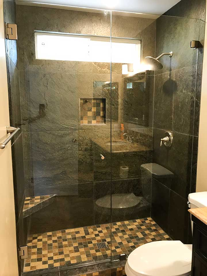 Shower with tile walls and a glass shower enclosure
